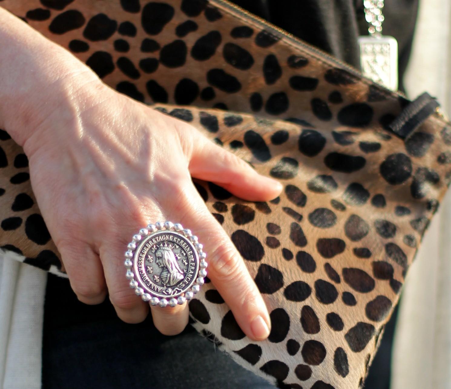 silver medallion ring, leopard clutch bag