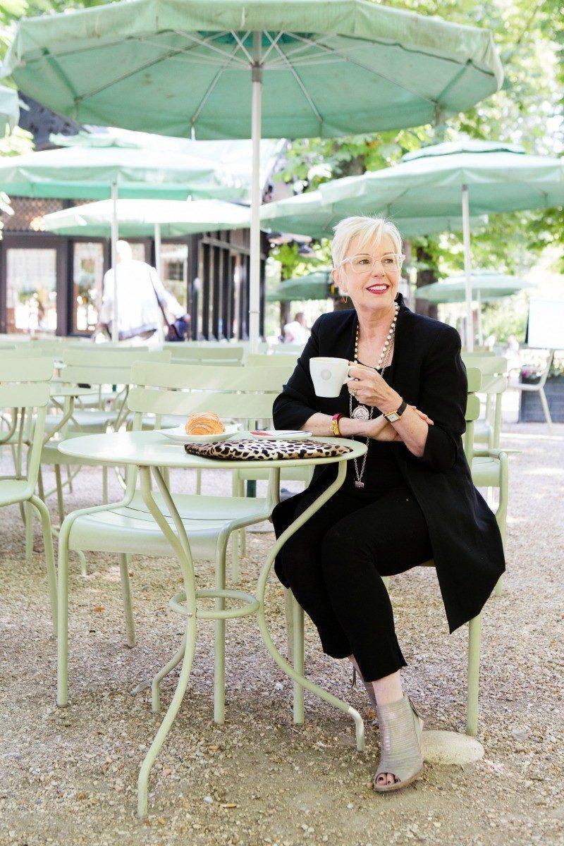 Style blogger Susan B. enjoys a café crème in Jardin du Luxembourg, Paris. Details at une femme d'un certain age.