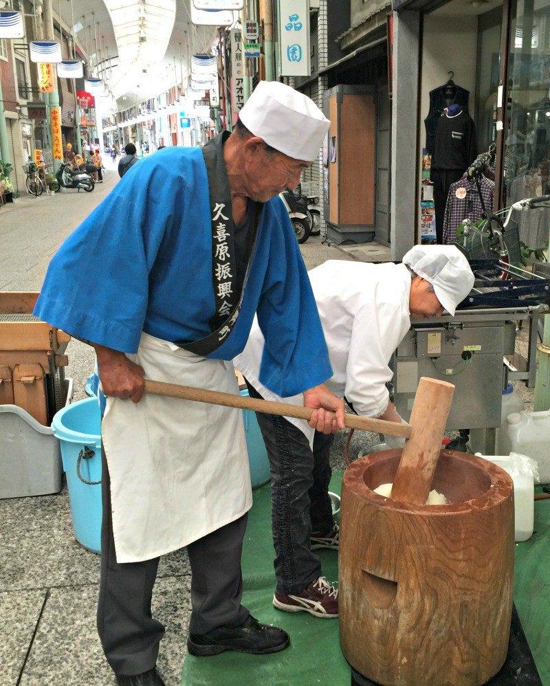 pounding rice to make dough