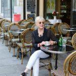 style blogger Susan B of une femme d'un certain age takes a break at a sidewalk cafe in Paris