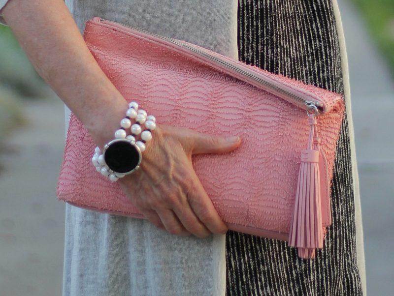Loeffler Randall fringe clutch and French Kande pearl bracelet. Details at une femme d'un certain age.