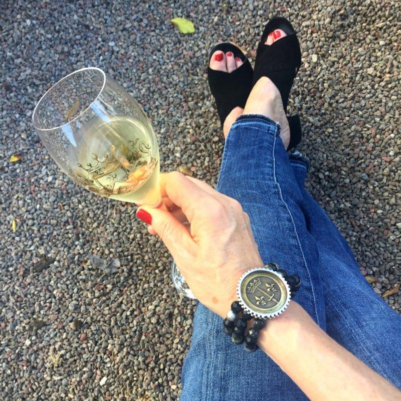 Detail: lifestyle blogger Susan B. wears a French Kande bracelet and Frame jeans. Details at une femme d'un certain age.