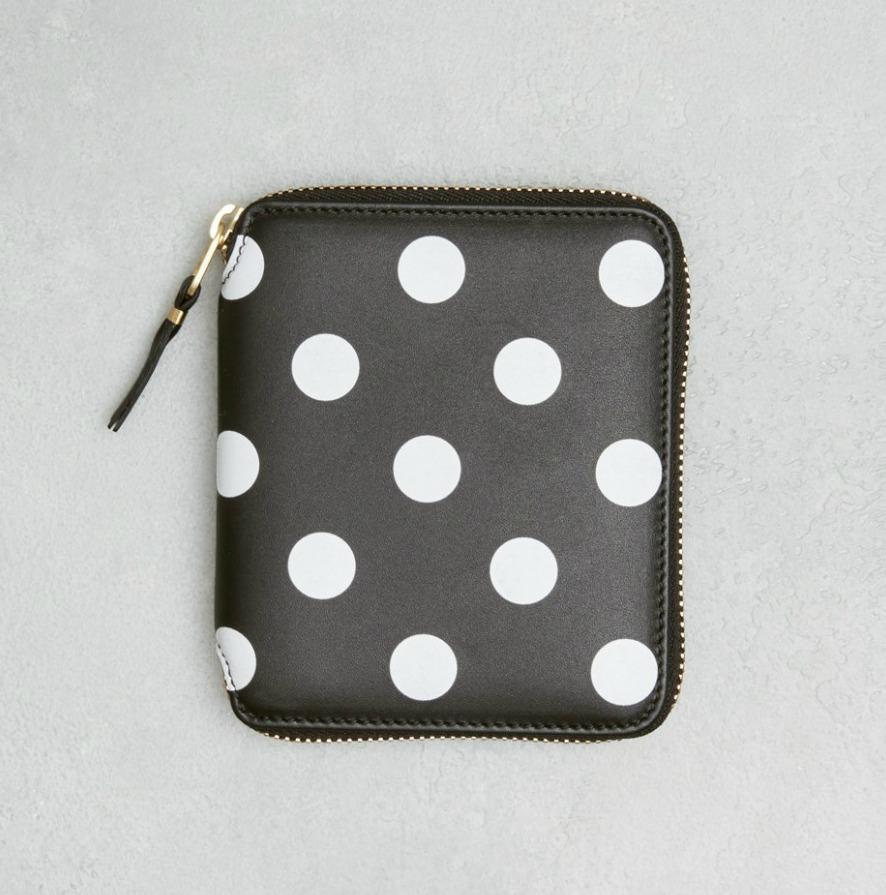 Leather polka dot zip wallet from Comme des Garcons. Details at une femme d'un certain age.