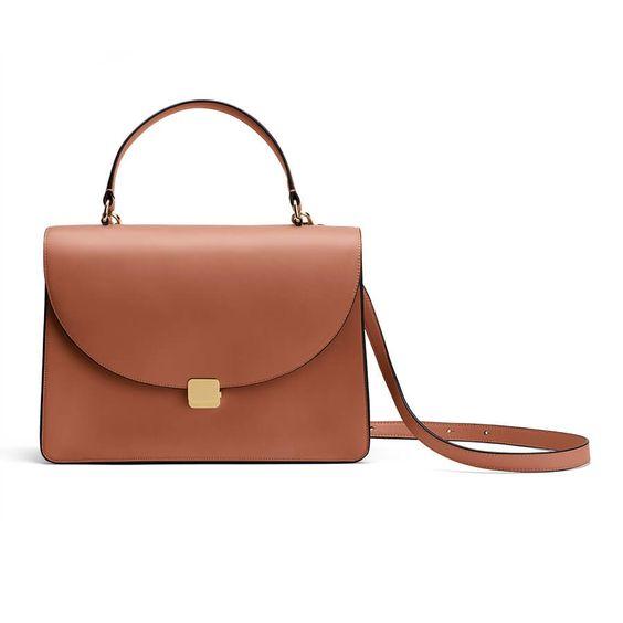 Saddle leather top handle satchel. Details at une femme d'un certain age.