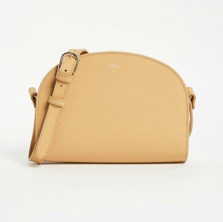 A.P.C. tan crossbody bag. Details at une femme d'un certain age.