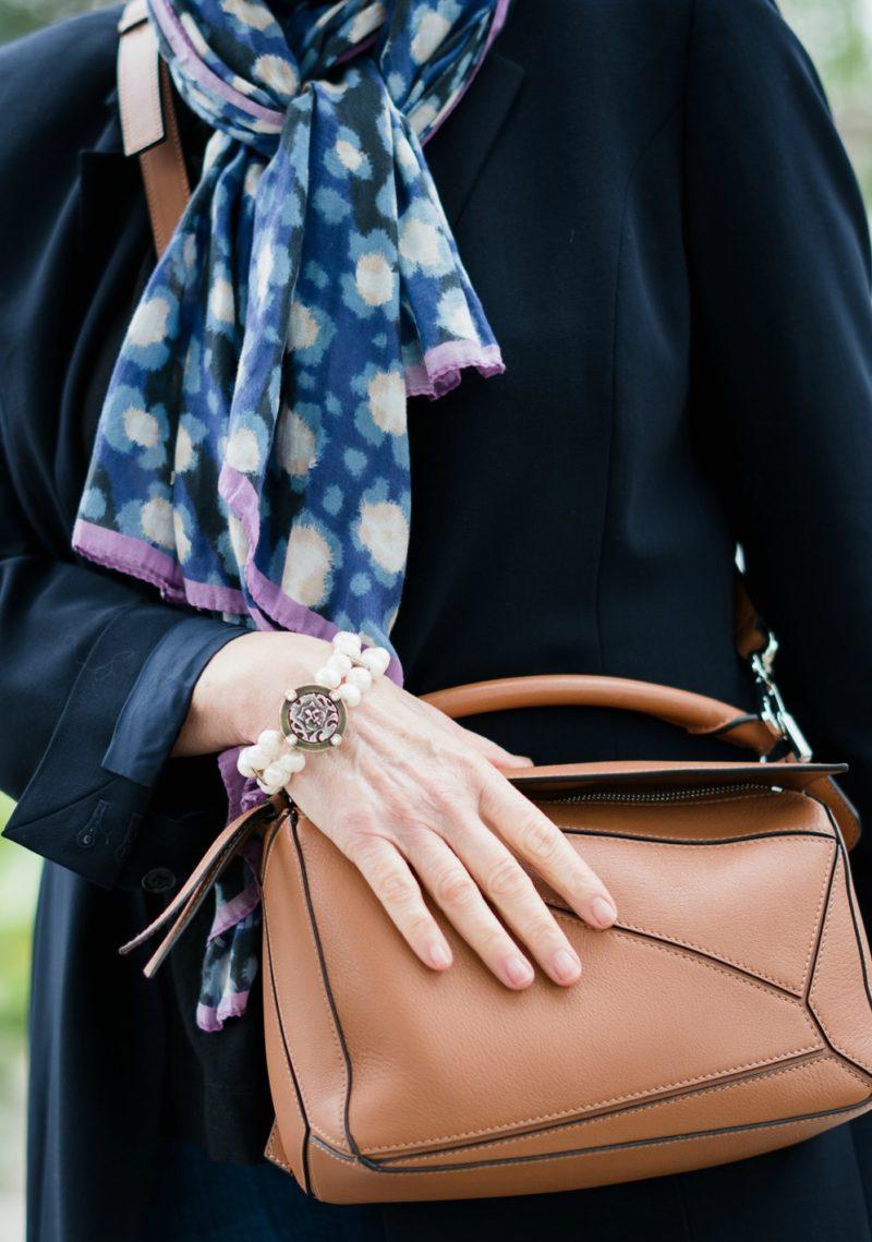 Kenzo cotton silk scarf, French Kande pearl bracelet, Loewe puzzle bag. Details at une femme d'un certain age.