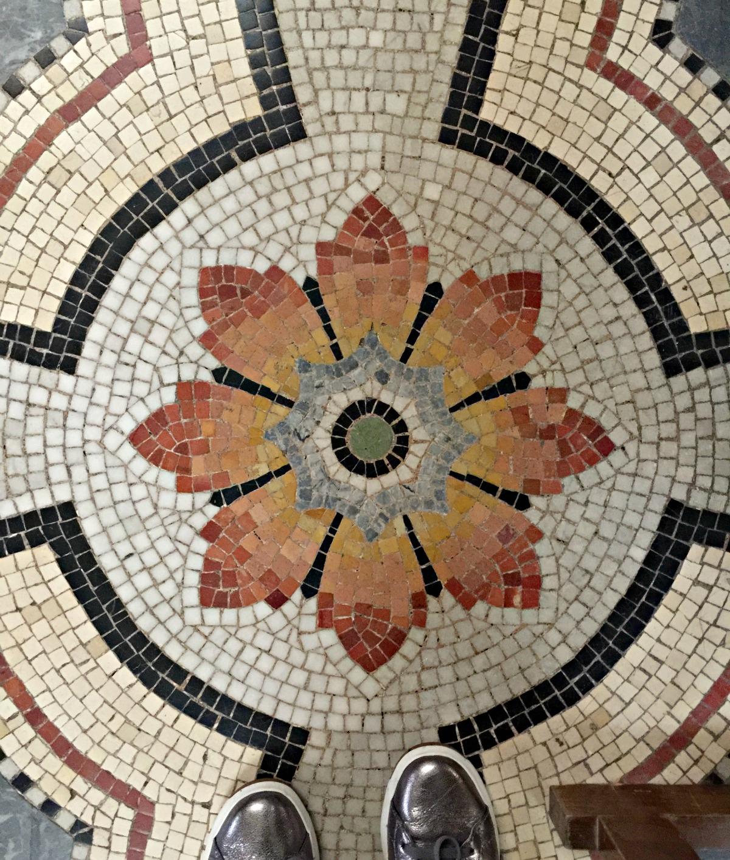 Floor mosaic at Basilique Notre Dame de Fourviere. Details at une femme d'un certain age.
