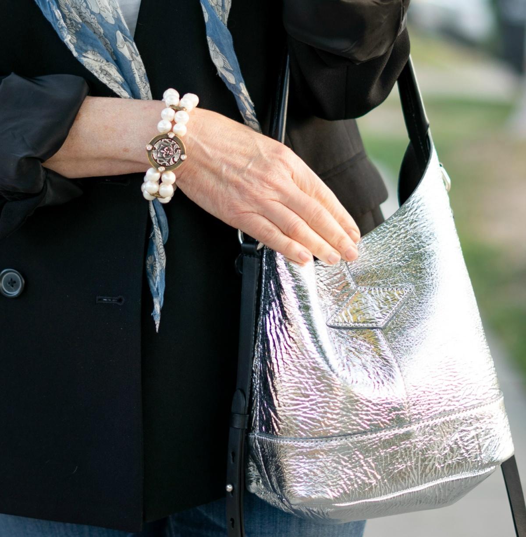 French Kande pearl bracelet, Rag & Bone metallic bucket bag. Details at une femme d'un certain age.