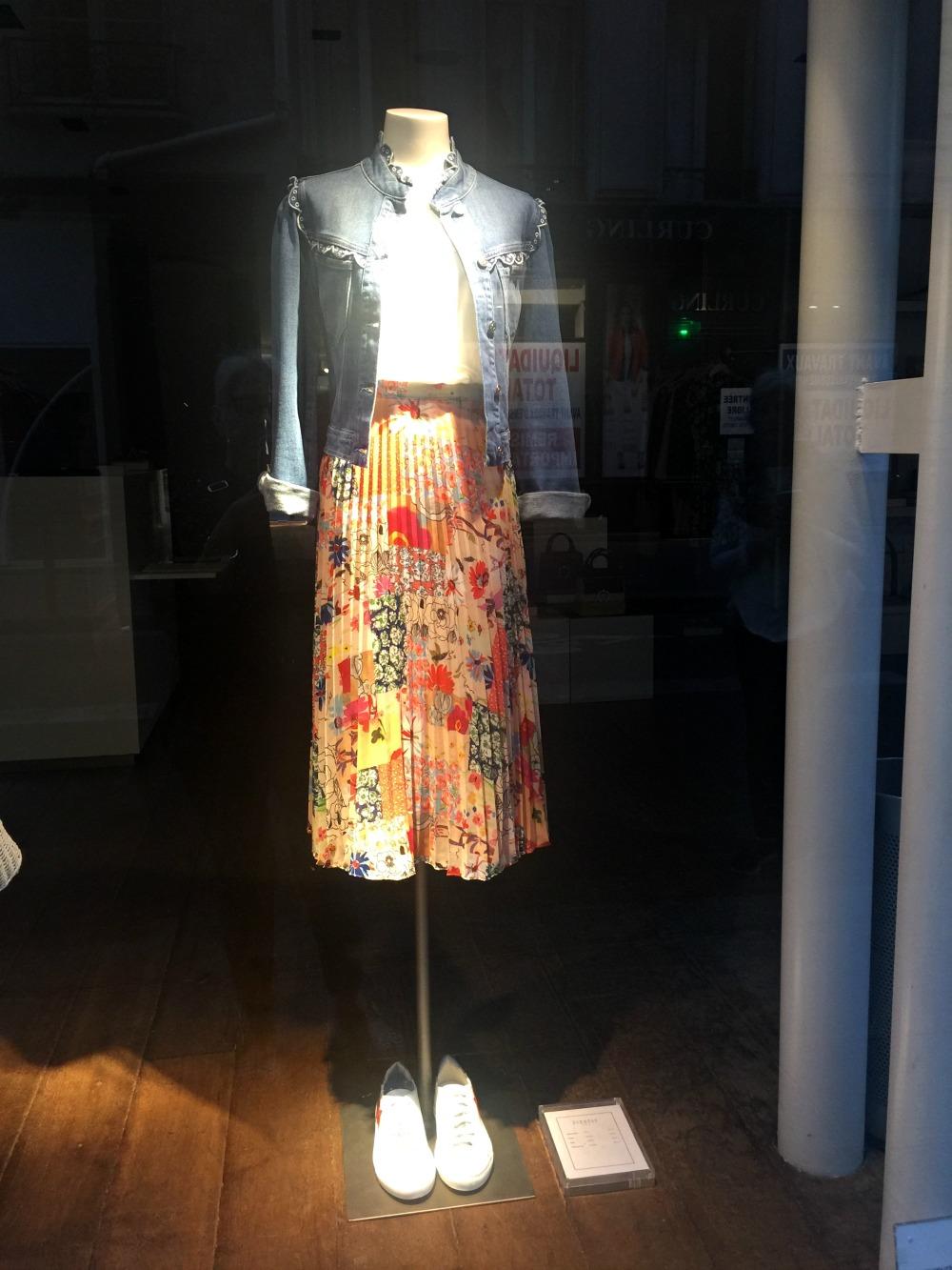 Pleated floral skirt in a Paris shop window. Details at une femme d'un certain age.