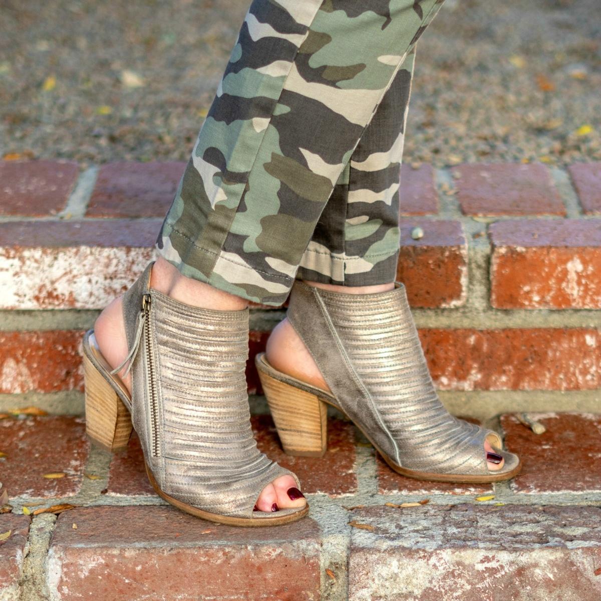Detail: style blogger Susan B. wears camo pants and metallic Paul Green sandals. Details at une femme d'un certain age.