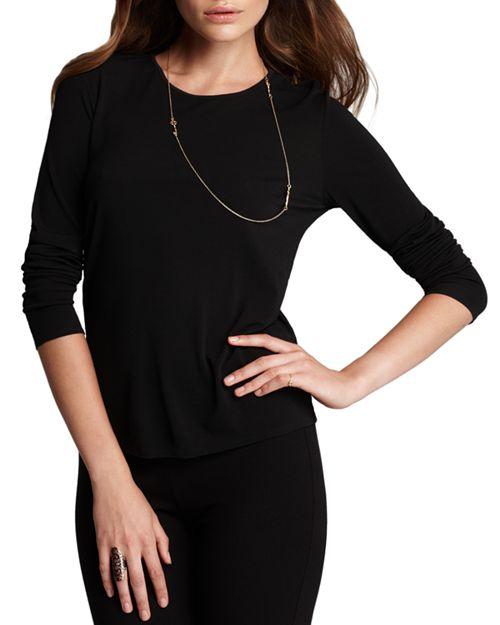 Eileen Fisher silk crewneck long sleeve tee in black. Details at une femme d'un certain age.