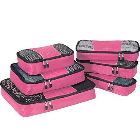Set of 6 packing cubes in pink. Details at une femme d'un certain age.