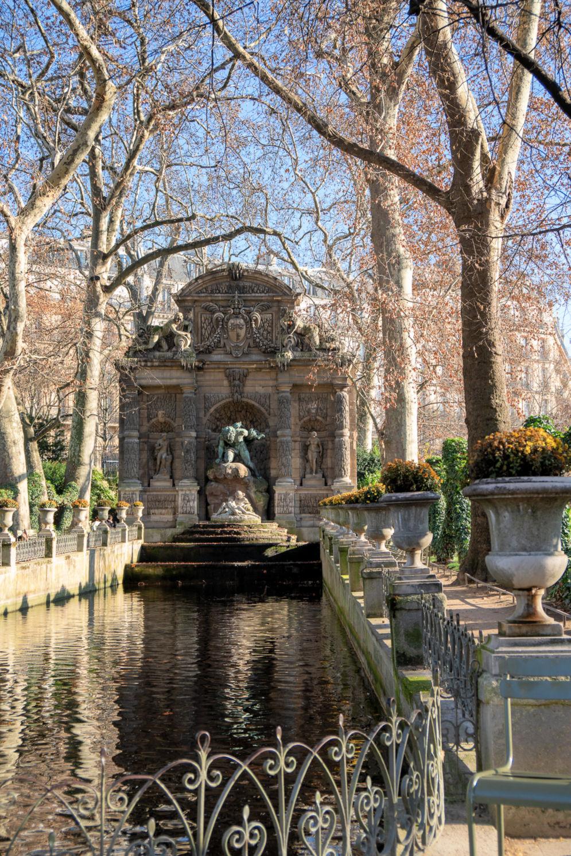 Fontaine de Medicis in Jardin de Luxembourg. December 2018. Details at une femme d'un certain age.