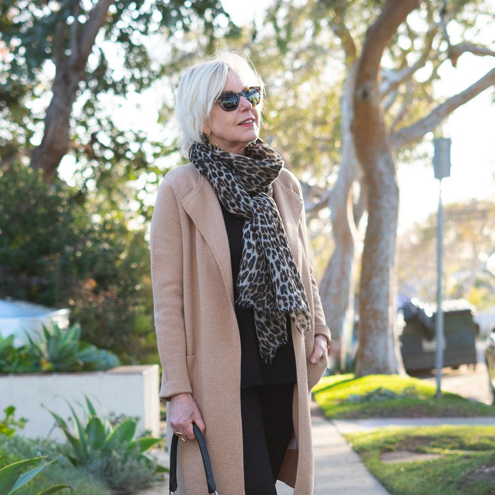 Style blogger Susan B. wears a camel J.Crew sweater-blazer over black separates. Details at une femmme d'un certain age.