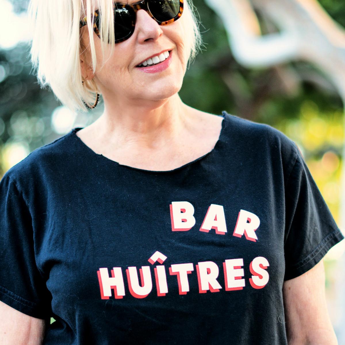 """Susan B of une femme d'un certain age wears a Clare V """"Bar Huitres"""" tee."""