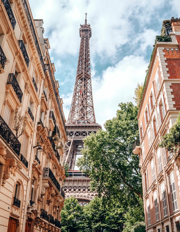 Eiffel Tower in Paris as seen from rue de l'Universite. Details at une femme d'un certain age.