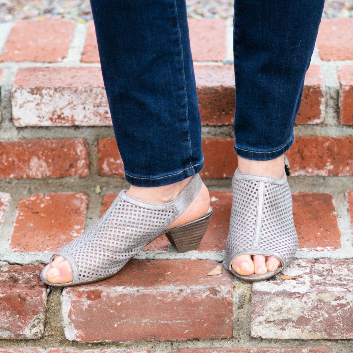 Detail: Susan B. of une femme d'un certain age wears Paul Green Lois sandals in silver metallic.