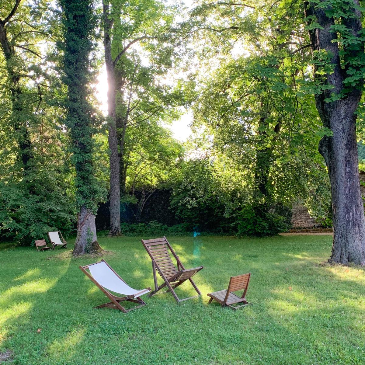 Lawn chairs in gardens at Hostellerie de Levernois, France. Details at une femme d'un certain age.