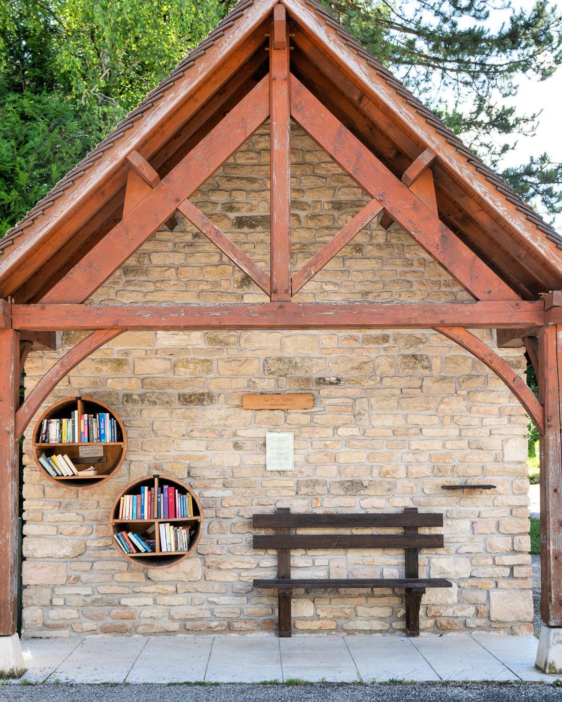 Roadside lending library in Levernois, France. Details at une femme d'un certain age.