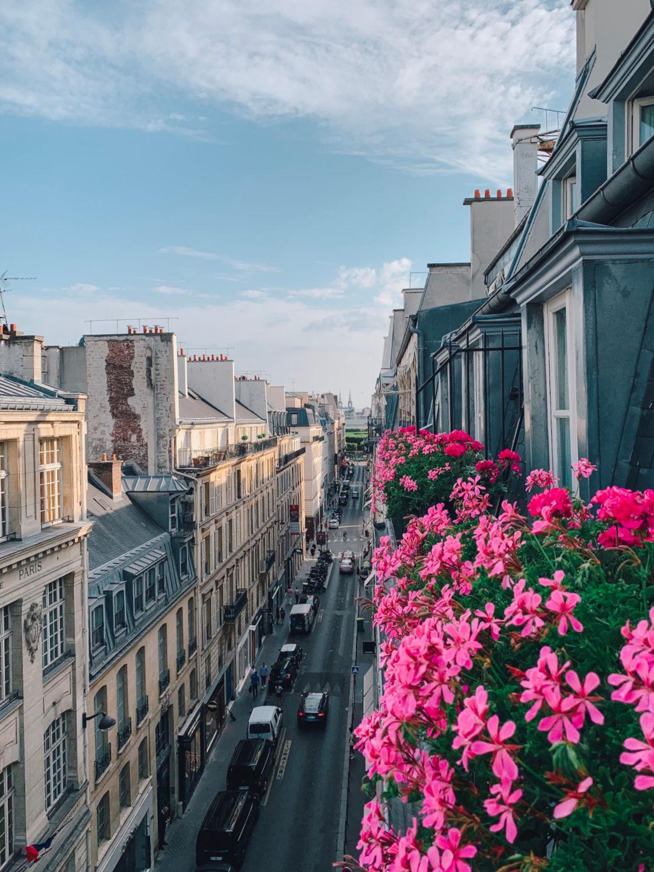Paris balcony view overlooking rue Cambon. Details at une femme d'un certain age.