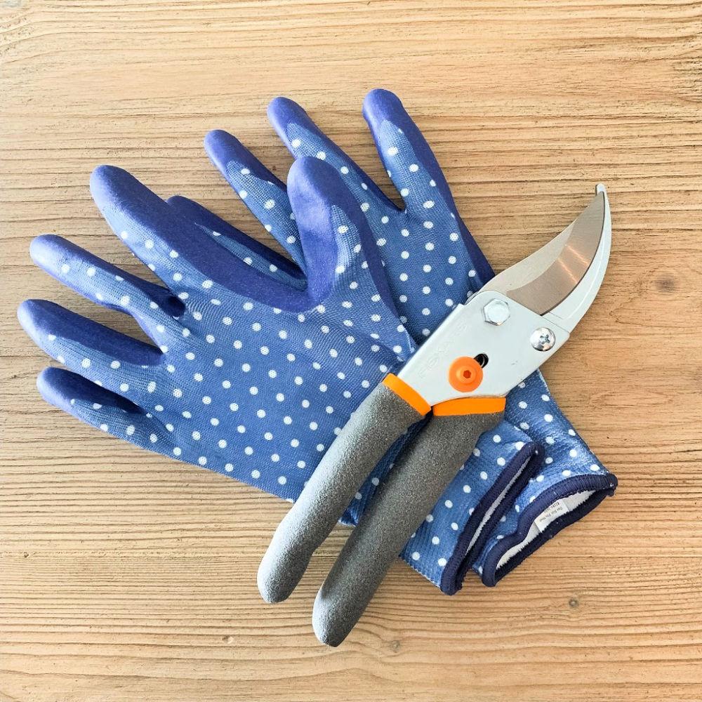 Polka dot gardening gloves and small pruning shears.