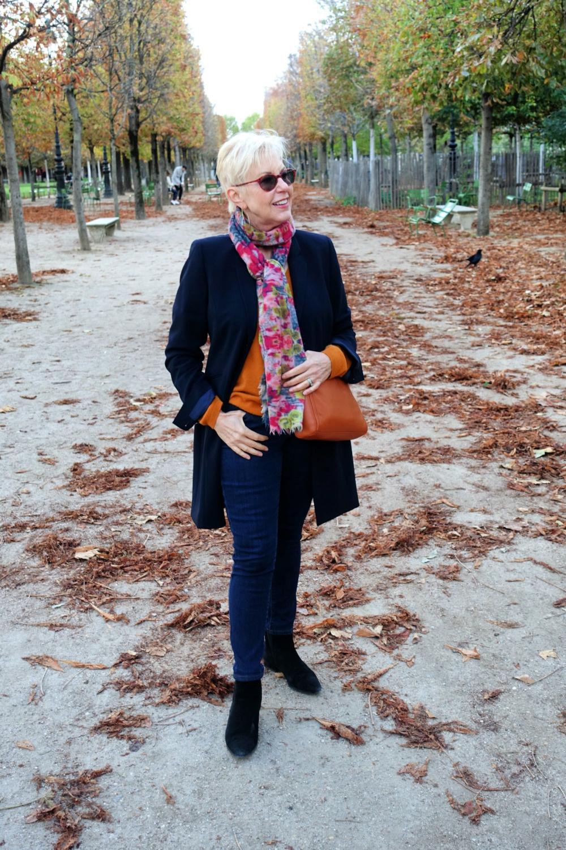 Susan B of une femme d'un certain age in Jardin des Tuileries, Paris in Fall. My favorite handbag for travel.