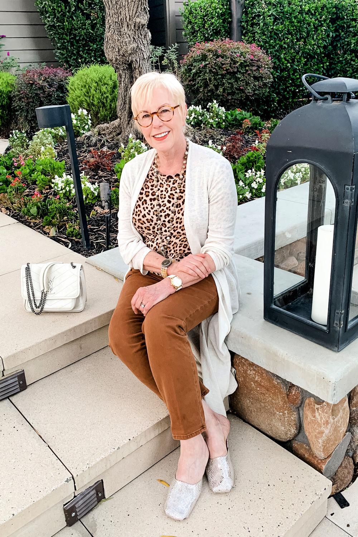 Susan B of une femme d'un certain age wears a leopard tee, duster cardigan, brown pants, YSL Niki bag.