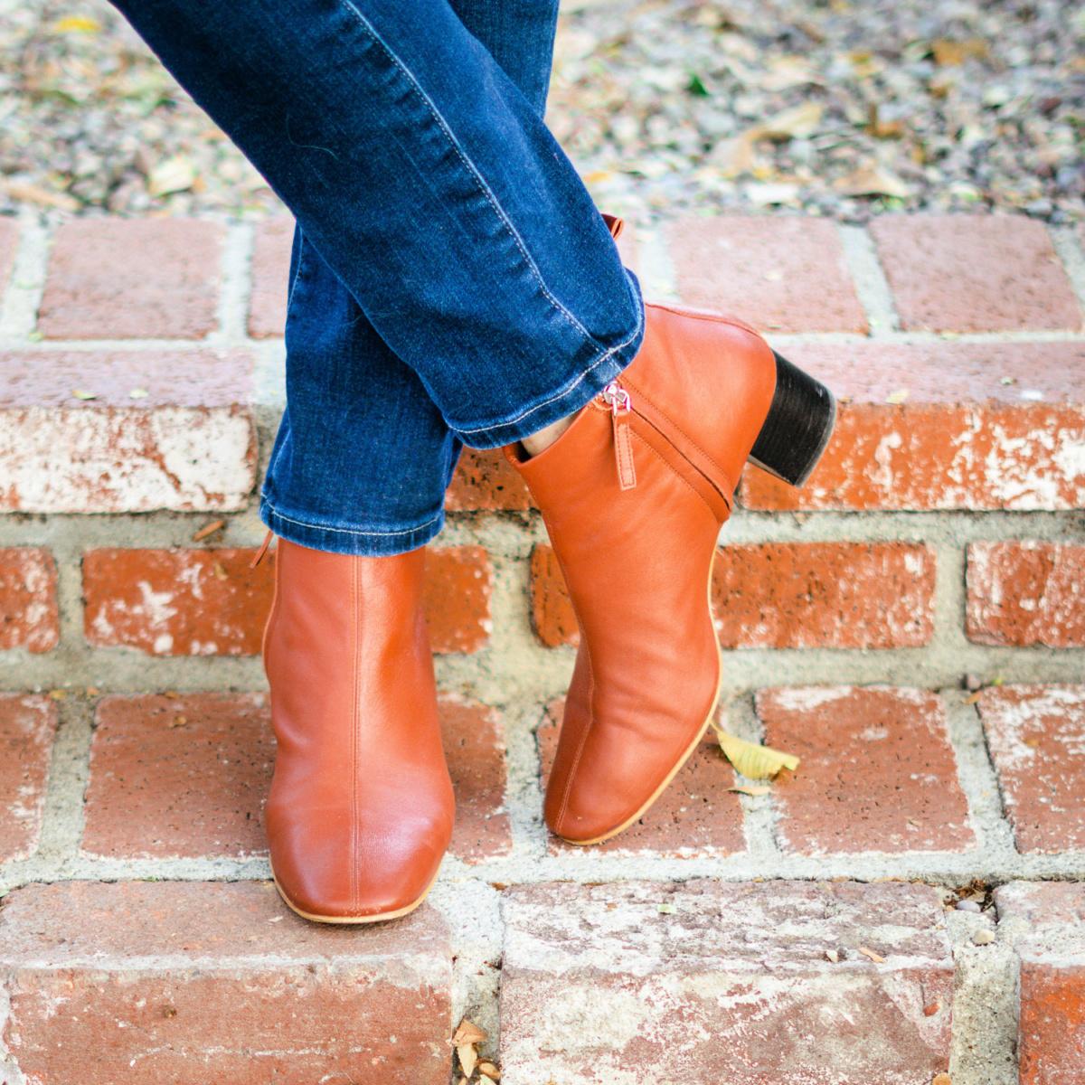 Detail: Susan B of une femme d'un certain age wears Everlane Day Boots in Brick.