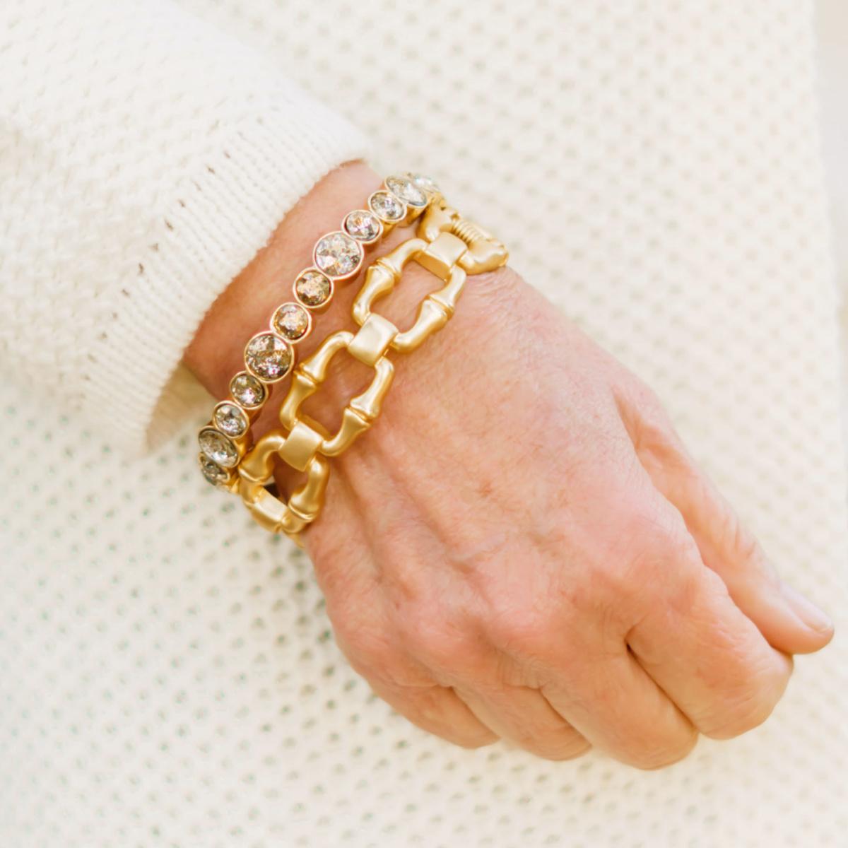 Detail: style blogger Susan B. wears gold bracelets and a textured cotton cardigan. Info at une femme d'un certain age.