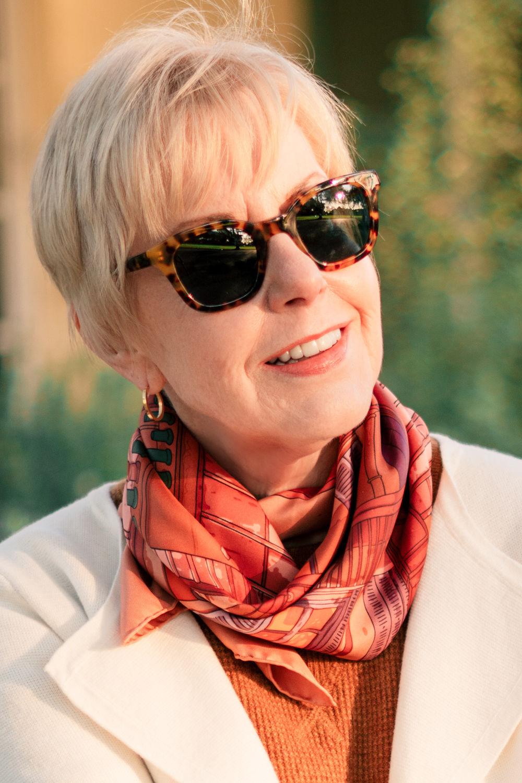 """Susan B of une femme d'un certain age wears Hermès """"Toits de Paris"""" scarf. Info at une femme d'un certain age."""