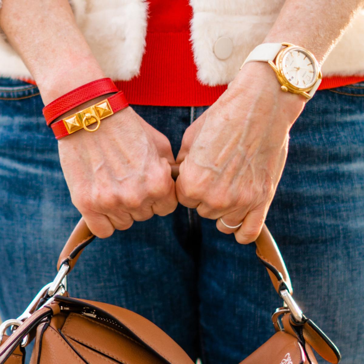 Detail: Susan B wears an Hermes Rivale leather bracelet. Info at une femme d'un certain age.