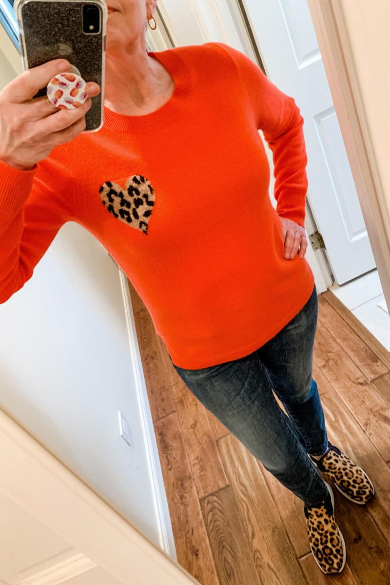 Susan B. wears a J.Crew cashmere sweater with leopard heart detail. Info at une femme d'un certain age.
