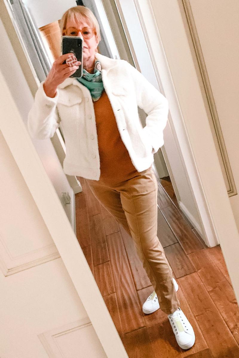 Susan B. wears a fuzzy trucker jacket and tan utility pants. Details at une femme d'un certain age.