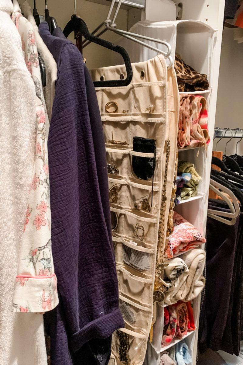 Closet organization: longer hanging items, jewelry & scarves. Details at une femme d'un certain age.