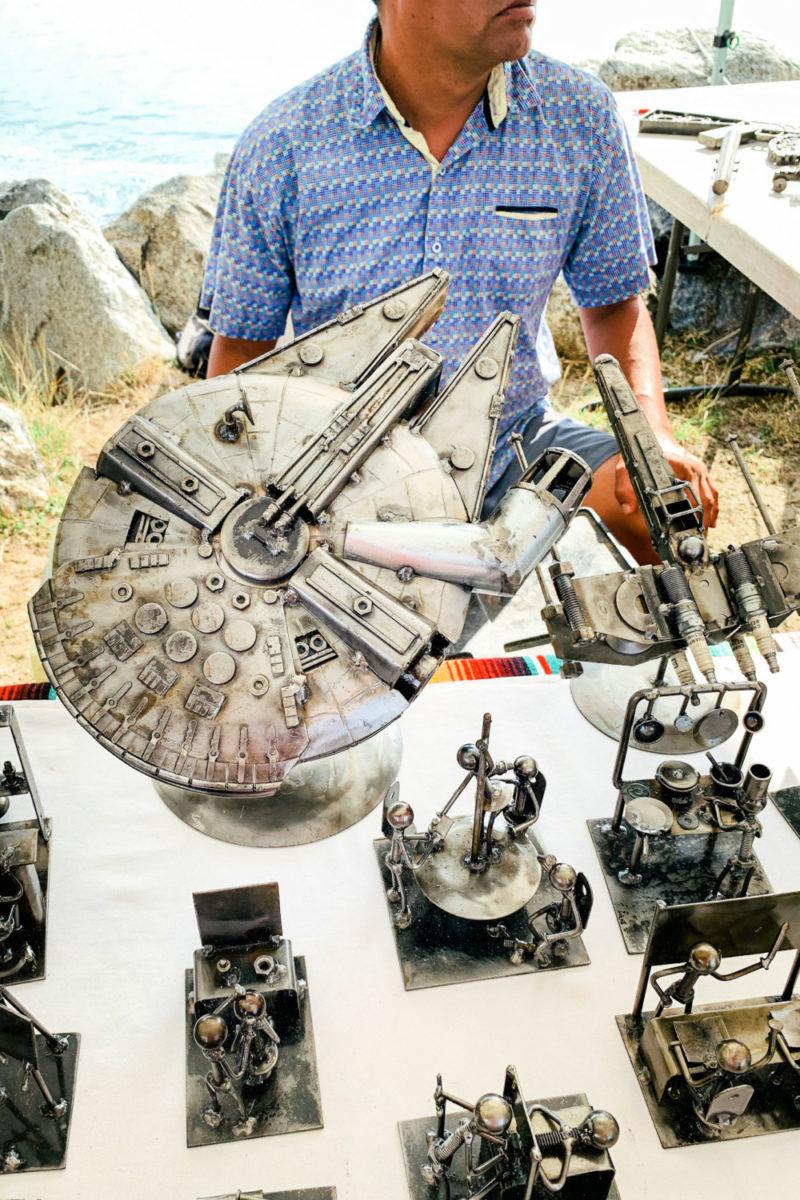 Metal artisan at La Cruz de Huanacaxtle mercado, Nayarit Mexico. Details at une femme d'un certain age.