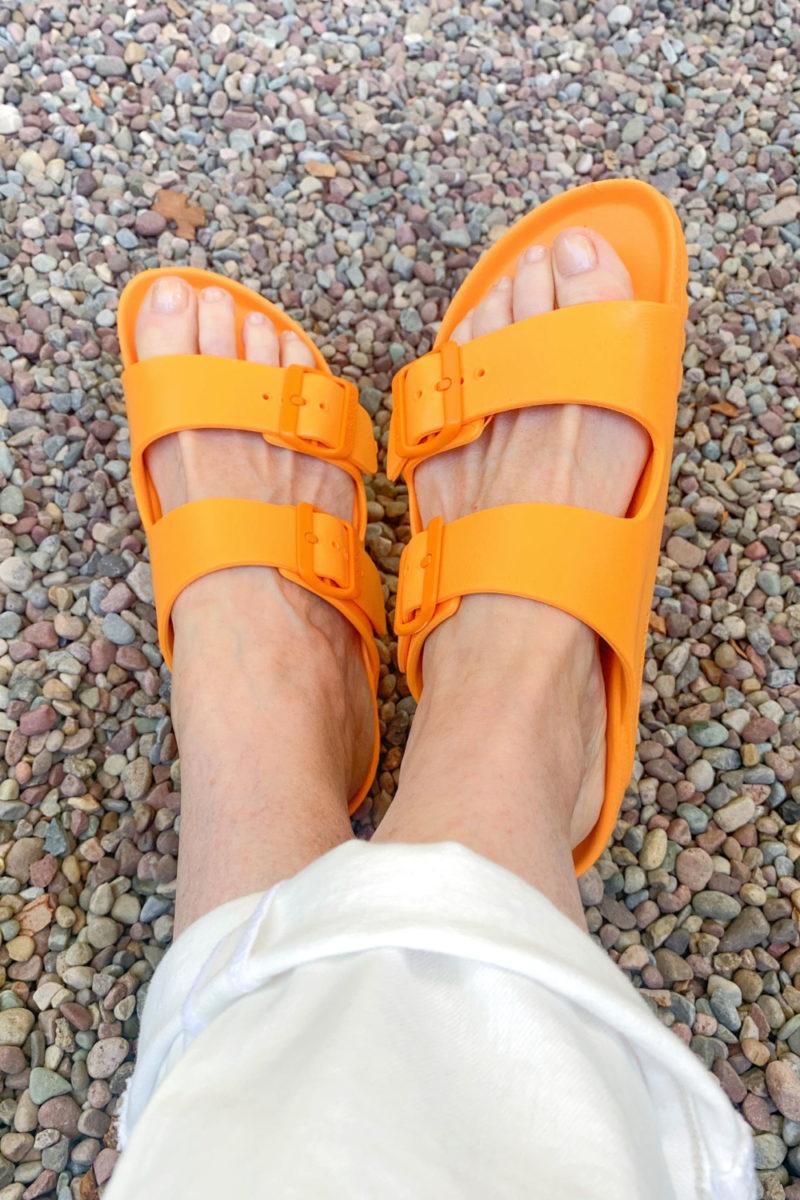 Susan B wears Birkenstock Essentials orange sandals. Details at une femme d'un certain age.
