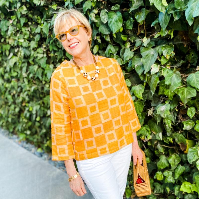 Susan B. wears an Ace & Jig top, Venetian glass bead necklace. Details at une femme d'un certain age.