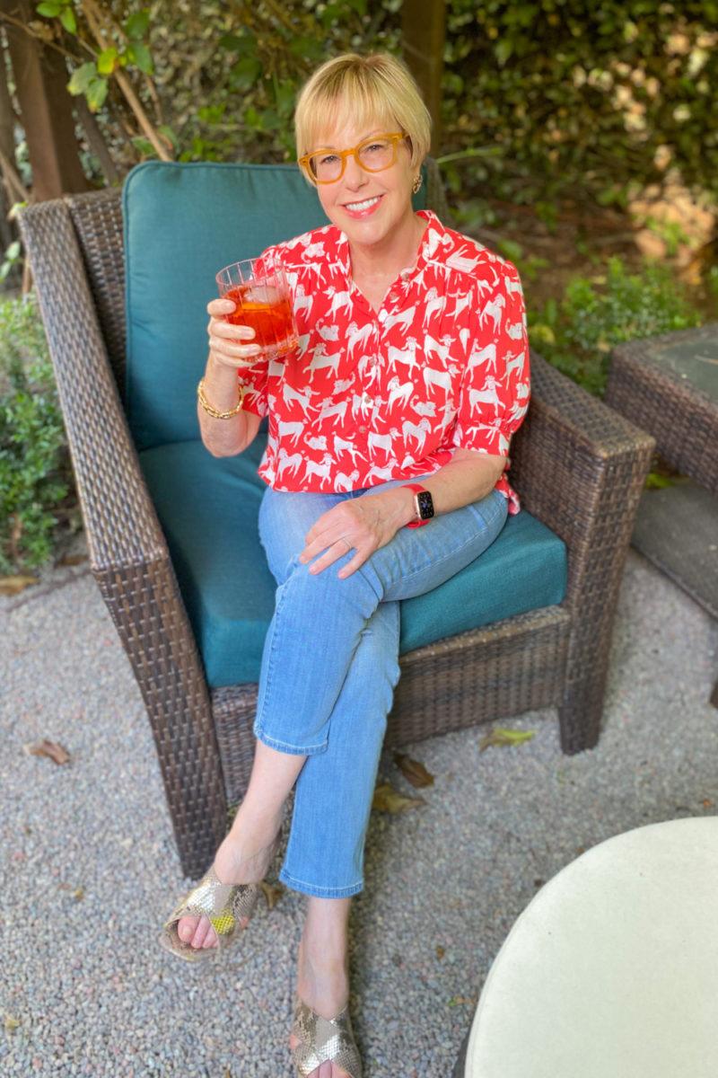 Susan B. wears a poodle print shirt, light wash jeans, and wishes you a Happy Fourth! Details at une femme d'un certain age.
