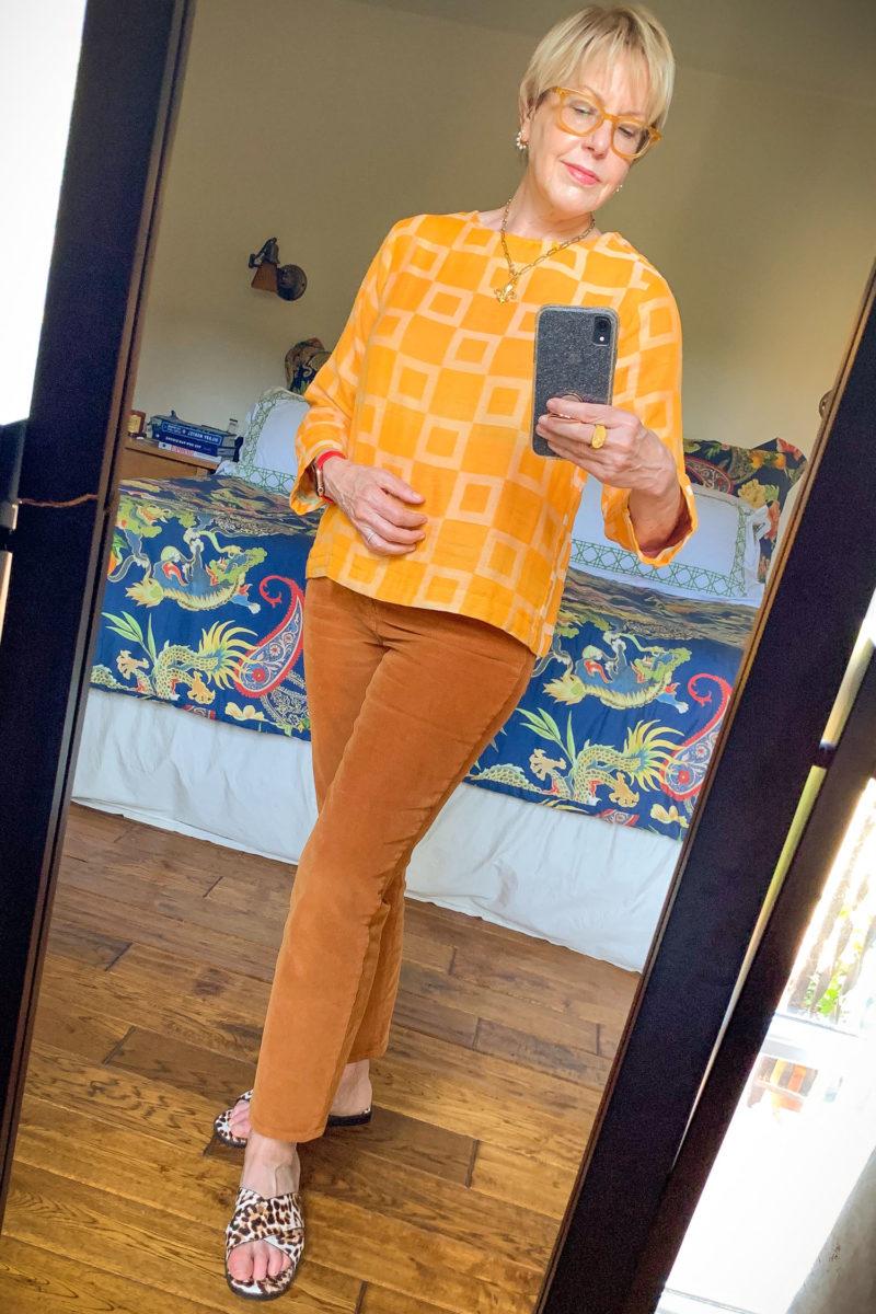 Susan B. wears a yellow cotton top, brown corduroy pants, and leopard print sandals. Details at une femme d'un certain age.