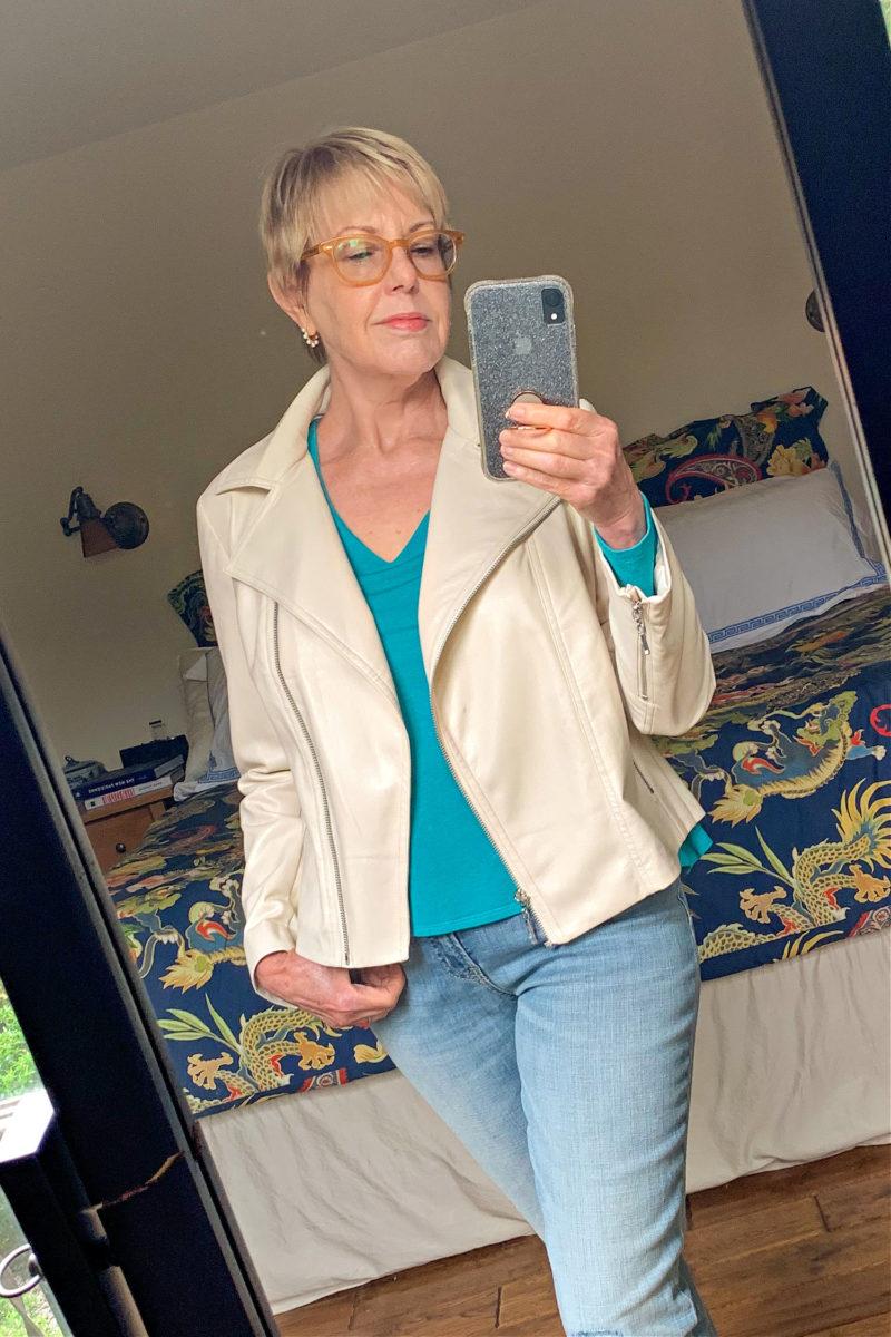 Susan B. wears a Chico's faux leather moto jacket in cream. Details at une femme d'un certain age.