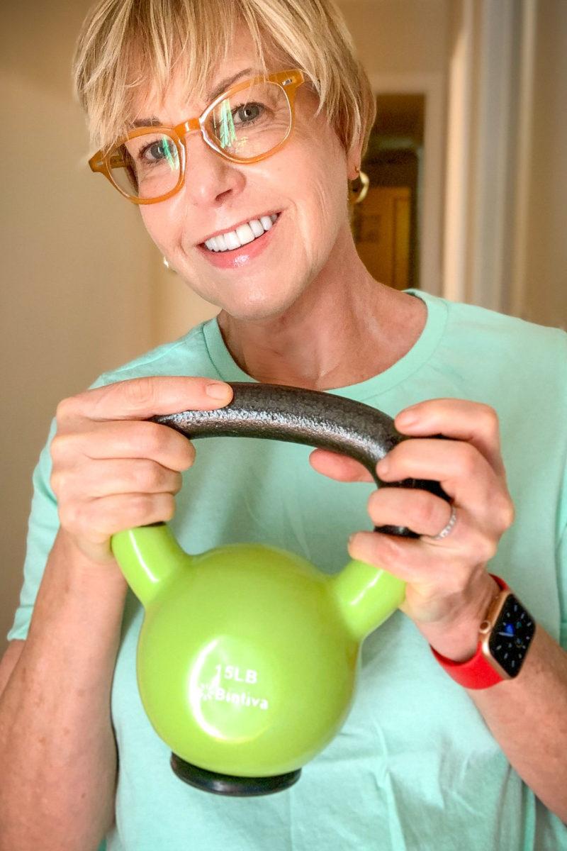 Susan B. with a 15 lb. kettlebell. Details at une femme d'un certain age.