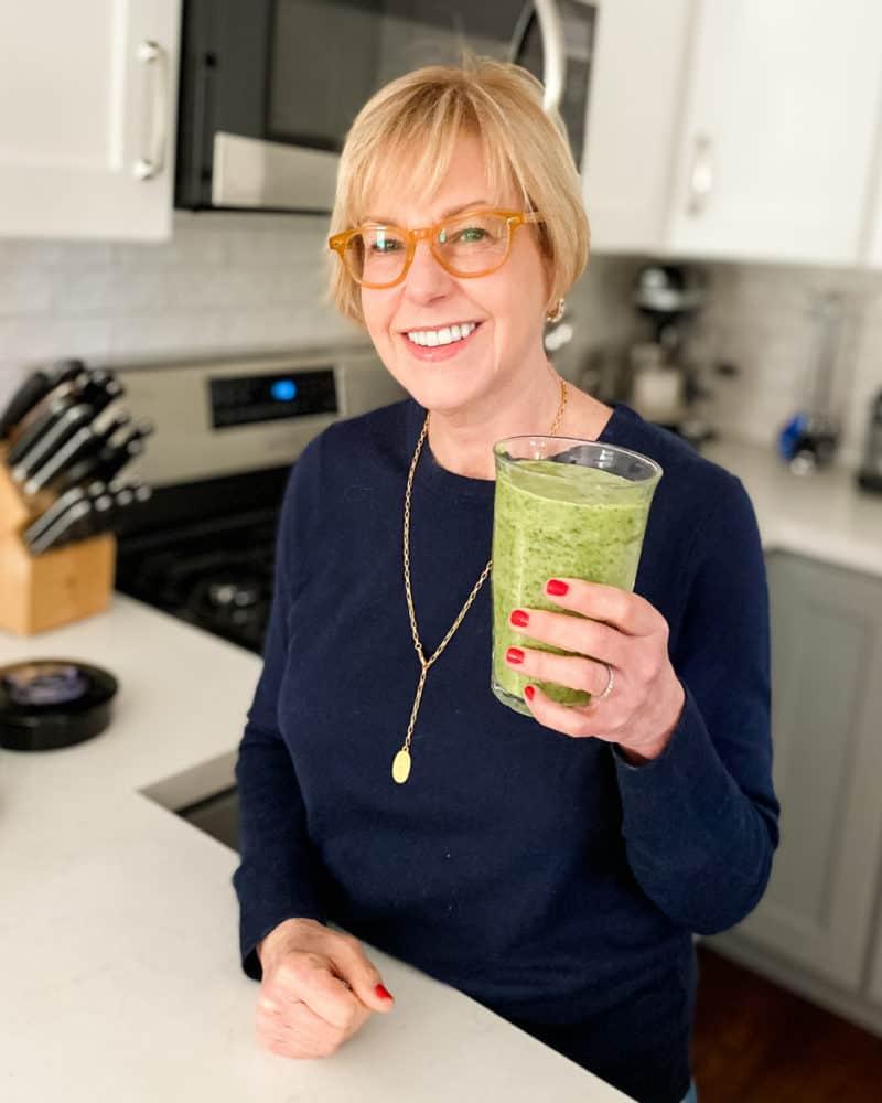 Cheers! Susan B about to enjoy a kale smoothie. Details at une femme d'un certain age.