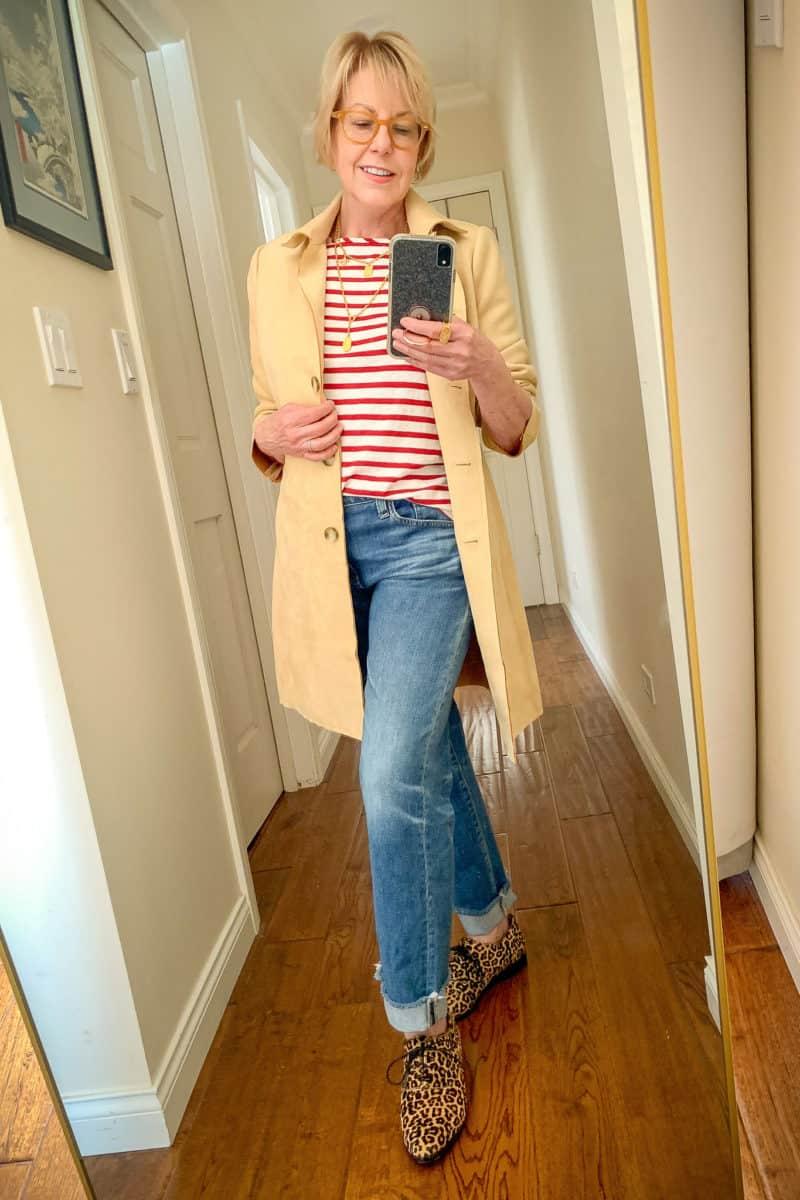 Susan B wears a faux suede tan jacket, red striped tee, boyfriend jeans and leopard print oxfords.