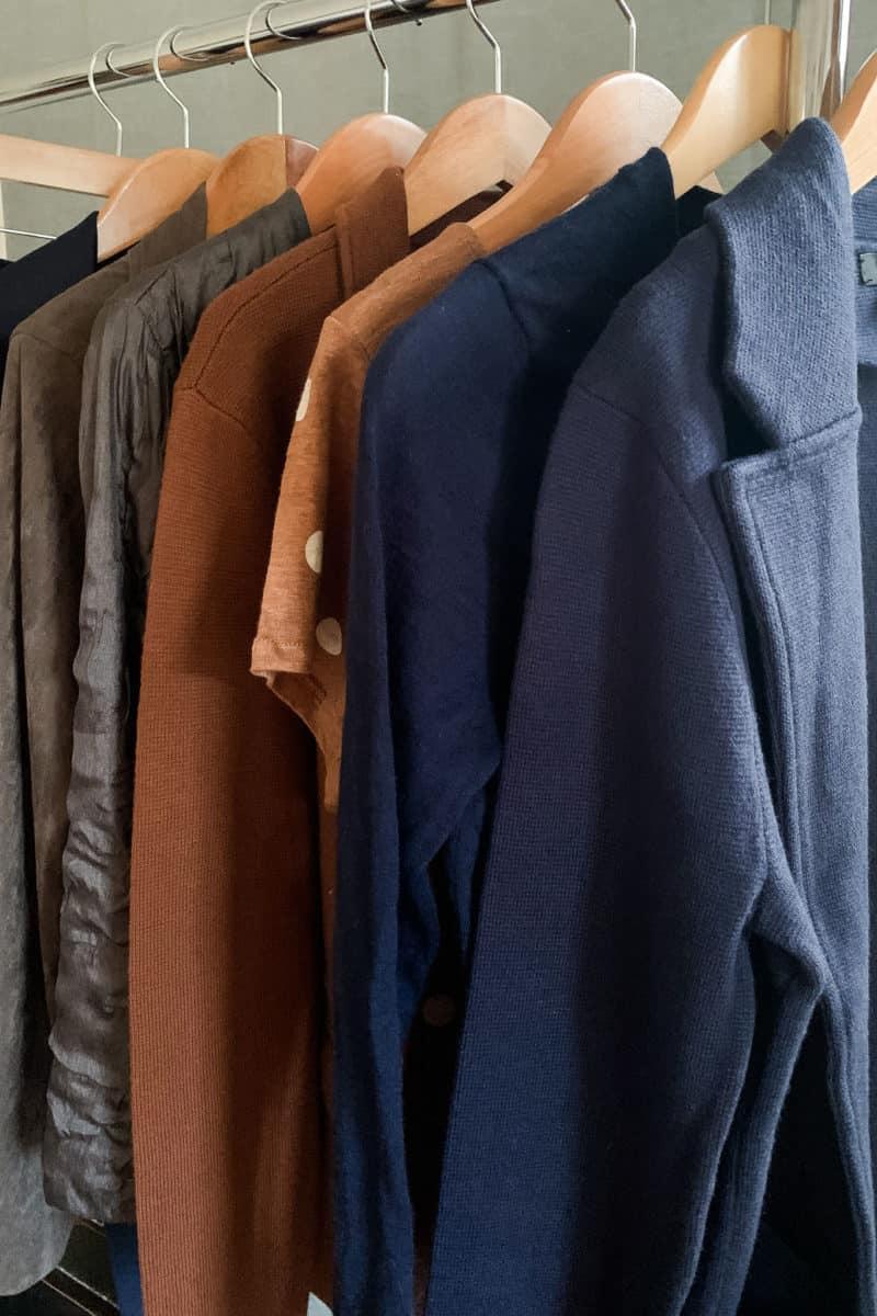 Neutral wardrobe basics in grey, brown, navy.