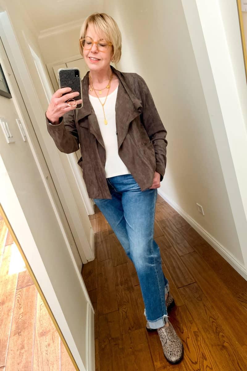Susan B. wears a Ruti faux suede jacket, Eileen Fisher shell, French Kande gold jewelry, boyfriend jeans, Clergerie oxfords.