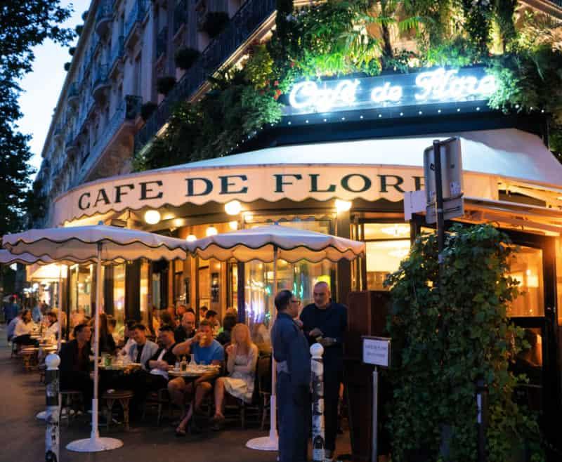 A summer evening outside Cafe de Flore in Paris.
