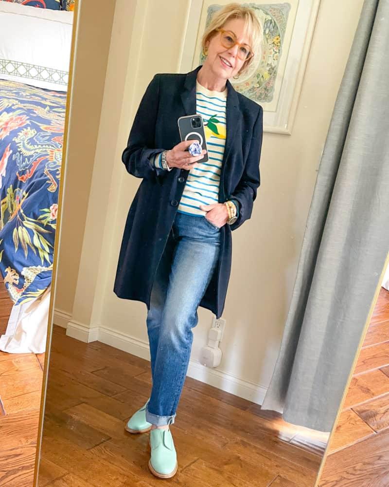 Susan Blakey wears a long navy jacket, striped sweater, boyfriend jeans and blue oxfords.