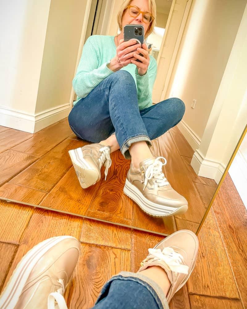 Susan Blakey wears Nero Giardini platform sneakers, jeans and Eileen Fisher linen sweater.