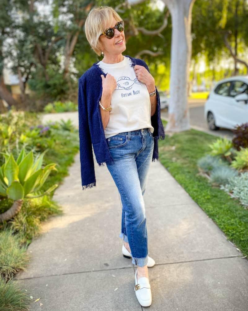 Susan B wears an IRO boucle jacket, Madewell graphic tee, boyfriend jeans, Gucci loafers.