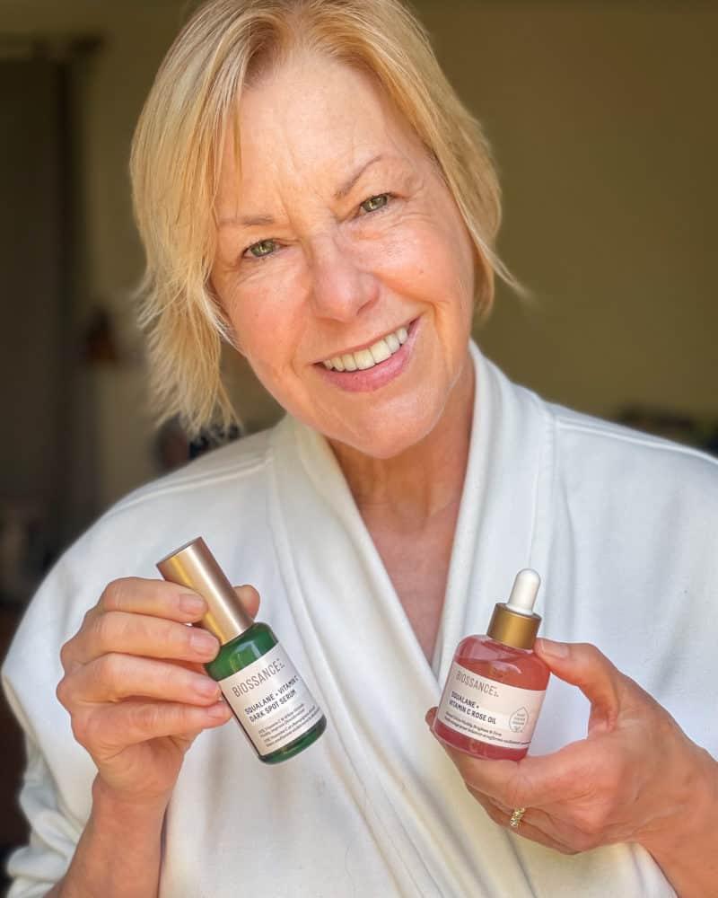 Susan B. with Biossance skincare: Squalane & Vitamin C dark spot serum and Squalane Vitamin C & Rose oil.
